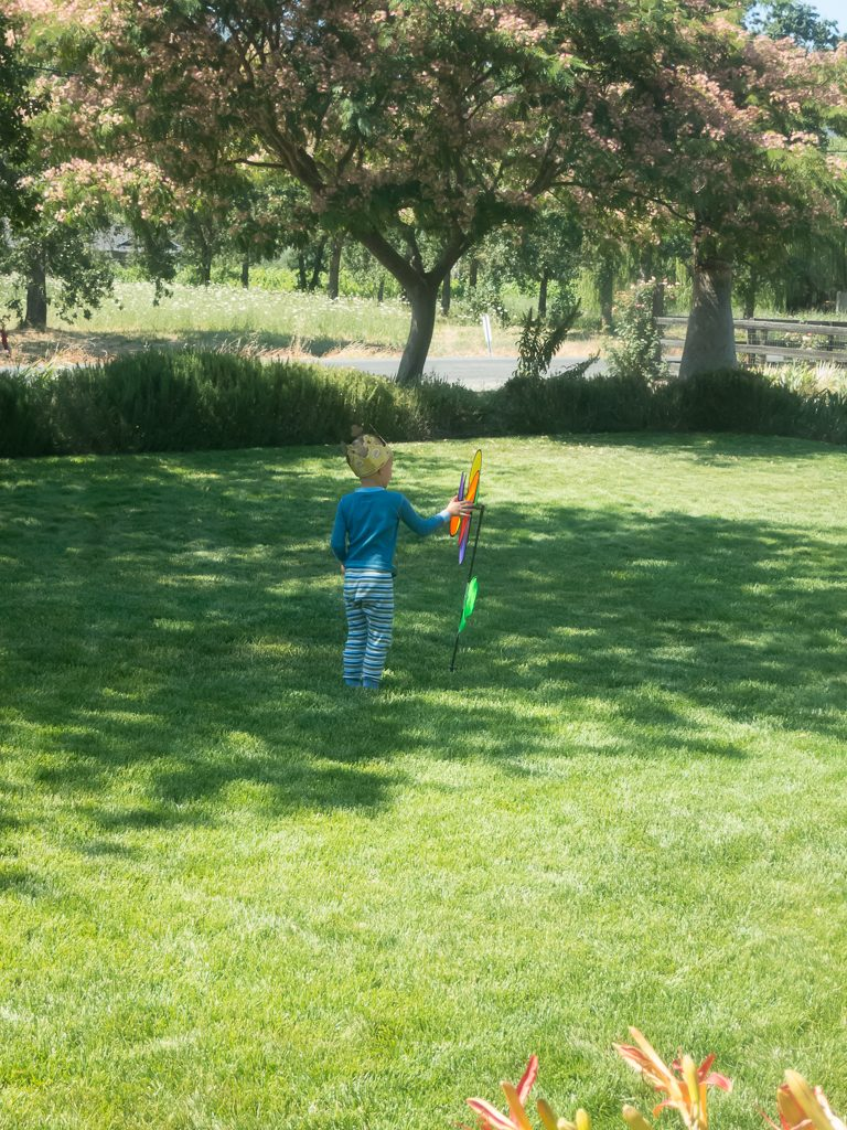 Austin playing with his pinwheel, still wearing his crown from Burger King (and travel PJs)