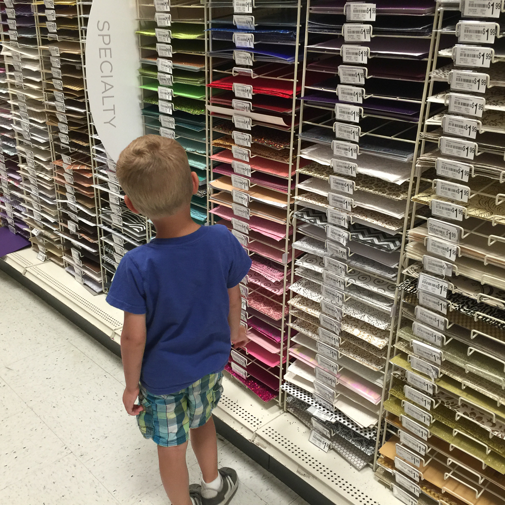 Austin browsing the scrapbook aisle