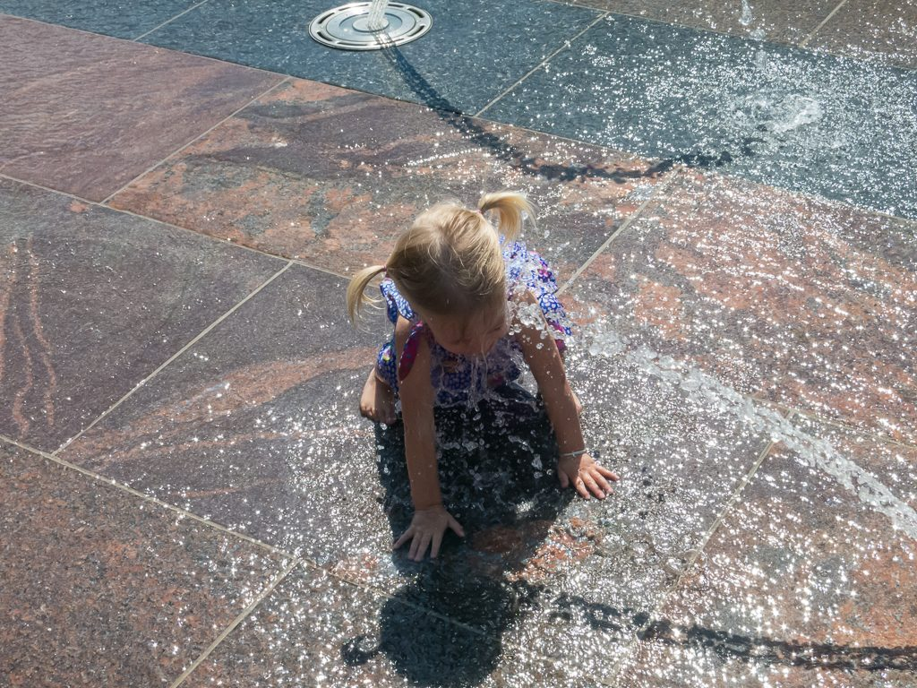 Playing in the fountains at Union Station in downtown Denver