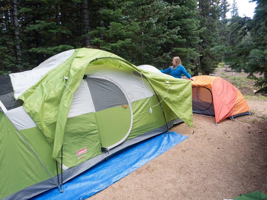 Amanda pitching the tent; I'm undoubtedly holding Addison
