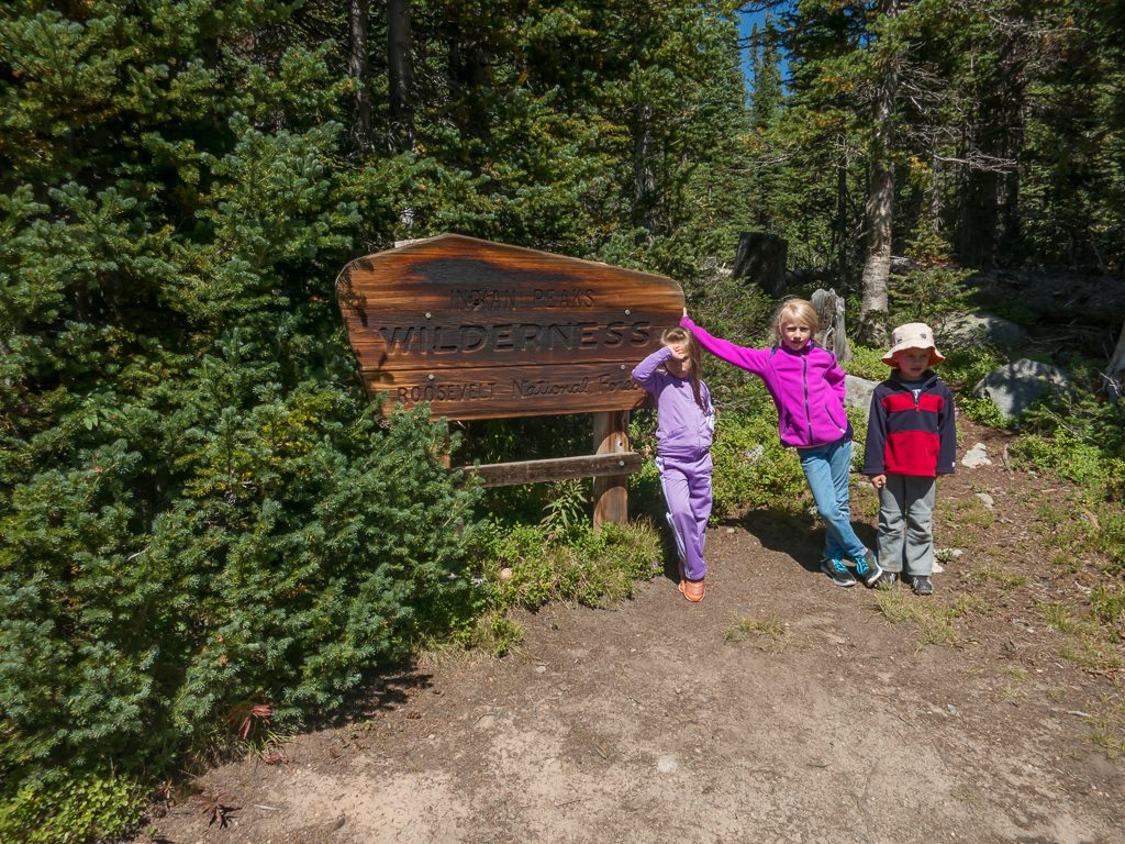 The group bigs at the trailhead sign
